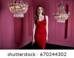 Stock photo sexy beauty woman wear skinny res dress style clothes for party celebrity long blond hair make up 670244302