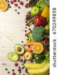 vegetables and fruits on wood... | Shutterstock . vector #670249858