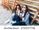 two pretty brunette girls... | Shutterstock . vector #670257736