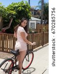 girl on her bicycle in san diego | Shutterstock . vector #670285756