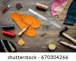 set of cobbler tools on brown... | Shutterstock . vector #670304266
