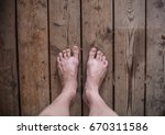 two legs and feet on old wooden ... | Shutterstock . vector #670311586