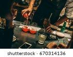bartender making alcoholic...   Shutterstock . vector #670314136