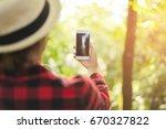 closeup of woman hands using... | Shutterstock . vector #670327822