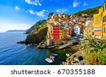 View of the colorful houses along the coastline of Cinque Terre area in Riomaggiore, Italy. - stock photo