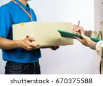 employees delivery man.postal... | Shutterstock . vector #670375588