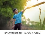 rural indian child playing... | Shutterstock . vector #670377382