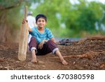 Rural indian child sitting on...