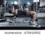 young man doing chest workout... | Shutterstock . vector #670410502