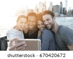 friends taking selfie picture... | Shutterstock . vector #670420672