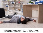 businessman dead on the office... | Shutterstock . vector #670422895