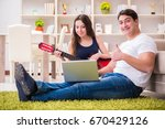 romantic pair playing guitar on ... | Shutterstock . vector #670429126