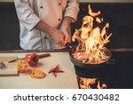 mature man professional chef...   Shutterstock . vector #670430482