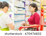 young woman with shopping cart... | Shutterstock . vector #670476832