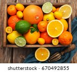 box with citrus fruits on a old ... | Shutterstock . vector #670492855