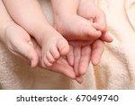 Children's Feet In The Hands Of ...