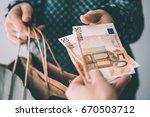 customer pays euro bills cash... | Shutterstock . vector #670503712