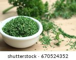 dried herb parsley leaves | Shutterstock . vector #670524352