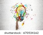 rear view of a blond woman... | Shutterstock . vector #670534162