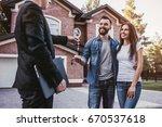 happy couple is taking keys... | Shutterstock . vector #670537618
