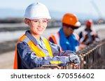 worker fixing steel rebar at... | Shutterstock . vector #670556602