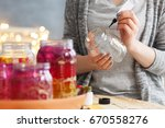 young woman decorating diy jars ... | Shutterstock . vector #670558276
