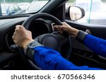 close up of woman test driving... | Shutterstock . vector #670566346