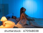 the woman with an insomnia sit...   Shutterstock . vector #670568038