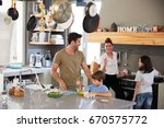 family in kitchen making... | Shutterstock . vector #670575772