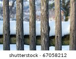 Old Wood Fence Covered By Snow