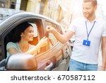 car rental agency employee... | Shutterstock . vector #670587112