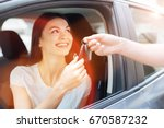 happy charming woman receiving... | Shutterstock . vector #670587232