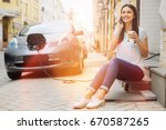 car owner drinking coffee and... | Shutterstock . vector #670587265