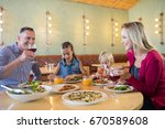 happy family talking while... | Shutterstock . vector #670589608