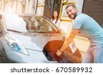 smiling man unplugging the... | Shutterstock . vector #670589932