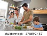 family in kitchen following... | Shutterstock . vector #670592452