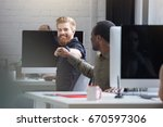 smiling bearded man giving a... | Shutterstock . vector #670597306
