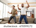 two excited male friends... | Shutterstock . vector #670599172