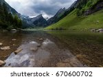 seealpsee the blue lake and... | Shutterstock . vector #670600702
