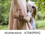 toddler girl hugging young... | Shutterstock . vector #670609042