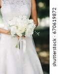 the bride in a white lace dress ... | Shutterstock . vector #670619872