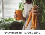 juice of carrots in women's... | Shutterstock . vector #670621042