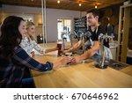 bartender serving drinks to...   Shutterstock . vector #670646962
