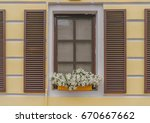 retro styled window with wooden ... | Shutterstock . vector #670667662