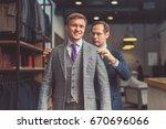 man in suit in atelier | Shutterstock . vector #670696066