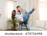 happy young man holding... | Shutterstock . vector #670726498