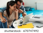woman buying online stocks... | Shutterstock . vector #670747492