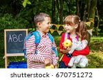 little students talk and laugh. ... | Shutterstock . vector #670751272