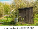 tiny house or shed at a plot of ...   Shutterstock . vector #670755886