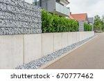 gabions in the garden | Shutterstock . vector #670777462